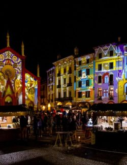Historic center of Pinerolo decorated with mapped projections.